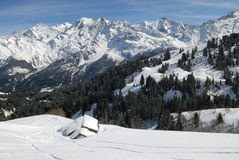 Chalet  in winter. Chalet under the snow in french alps in winter, in front of the Mont-Blanc Stock Image