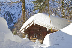 Chalet in winter Stock Images