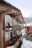 Chalet in winter. Chalet balcony in winter in the Swiss Alps royalty free stock photos