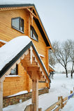 Chalet, wooden house and snow. Traditional suburban home, comfortable and warm in winter, residential structure, building exterior, non-urban scene, residential Stock Images
