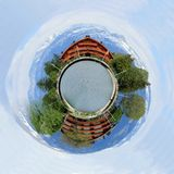 Chalets as a planet Royalty Free Stock Photo