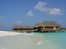 Chalets del agua en los Maldives Foto de archivo