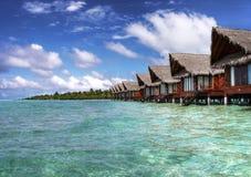 Chalets maldivos del océano Fotografía de archivo libre de regalías