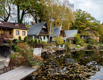 Chalets and a pond Royalty Free Stock Image