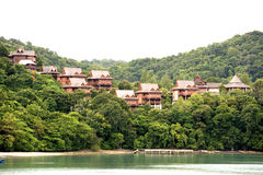 Chalets in the Tropical Rainforest. By the sea Stock Photos