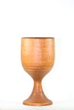 Chalice. A vertical picture of a wooden chalice on a white background stock image