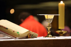 Chalice on the altar during mass. Chalice on the altar during the distribution of Holy Communion royalty free stock image