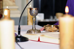 Chalice on the altar for worship. Golden chalice on the altar for worship Stock Image