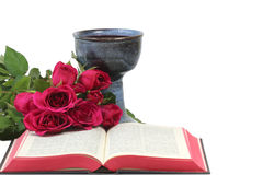 Chalice, bible and roses on white background Stock Photo