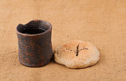 Chalice And Bread. Still life with chalice and bread on the textile tablecloth royalty free stock photography