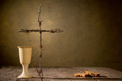 Chalice and bread on the wooden table Stock Photography