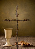 Chalice and bread on the wooden table Royalty Free Stock Photos