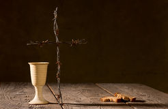 Chalice and bread on the wooden table Stock Photo