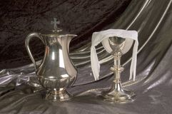 Chalice and Ewer. A silver Chalice and Ewer for Communion stock photography