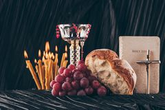 Free Chalice, Holy Bible, Christian Cross, Candles And Food Royalty Free Stock Images - 120876789