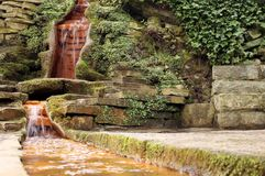 Chalice Well Spring, Glastonbury, UK. Chalice Well is one of the best known holy wells in Britain, steeped in myth and legend. The water appears to have a Royalty Free Stock Image