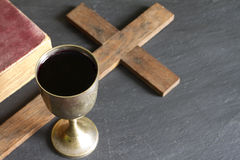 Chalice of wine bible and cross Royalty Free Stock Images