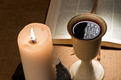 Chalice of wine and bible Royalty Free Stock Photo