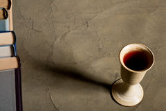 Chalice of wine with books Royalty Free Stock Photography