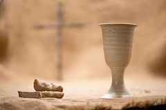 Chalice Of Wine With Bread. On The Burlap royalty free stock photography