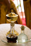 Chalice, wine, water. A chalice, wine and water used in a mass royalty free stock photos