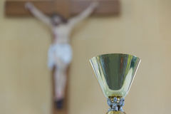 Chalices. Jesus blurred are background Stock Images