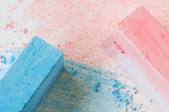 Chalk. Blue and pink pastel chalk on a white background stock photography