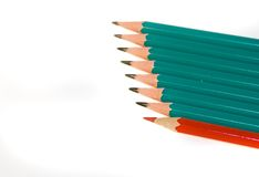 Chalk. Red and green chalk and pencils on white background royalty free stock photo