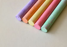 Chalk. Blackboard chalk in various colors on a cream colored surface Stock Image