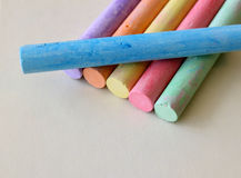 Chalk. Blackboard chalk in various colors on a cream colored surface Royalty Free Stock Photography