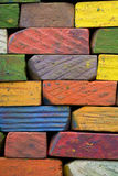 Chalk. A brickwall of used colored chalks Stock Photos