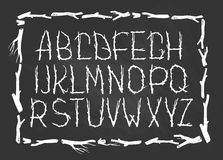 Chalk Alphabet made of branches of tree  on the chalkboard.  Royalty Free Stock Photo