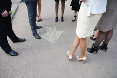 Chalk arrow on road, group of people around Stock Photo