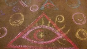 Chalk art all seeing eye. Chalk art Illumi Eye bubbles colorful stock photography