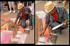 Chalk artist at work stock photography