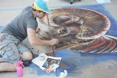 Chalk artist working sidewalk Stock Image