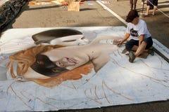 Chalk Artist Works To Draw Halloween Scene On Street Stock Photos