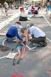 Chalk Artists Draw Halloween Scene On Street Stock Photography
