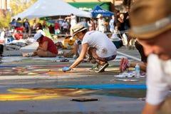 Chalk Artists Draw Halloween Scenes On Street Stock Photo