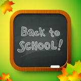 Chalk Back to School sign on black school board Royalty Free Stock Photos