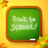 Chalk Back to School sign on green school board Stock Images