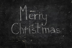 Chalk on black board: Merry Christmas Royalty Free Stock Photo