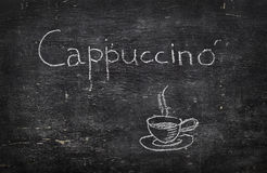 Chalk on blackboard: Cappuccino Stock Images