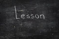 Chalk on blackboard: Lesson Stock Photo