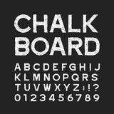 Chalk board alphabet font. Distressed vintage letters and numbers on a dark background. Vector typeface for your design Royalty Free Illustration