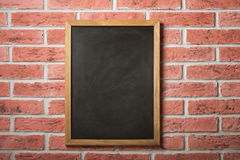 Chalk board on a brick wall Royalty Free Stock Photos