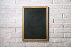 Chalk board on a brick wall Stock Photo