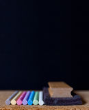 Chalk board colors and eraser Stock Photo