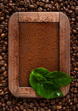 Chalk board with ground coffee and coffee grains in vintage style Royalty Free Stock Photo