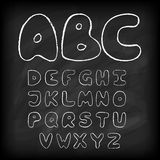 Chalk board hand drawn alphabet Royalty Free Stock Images